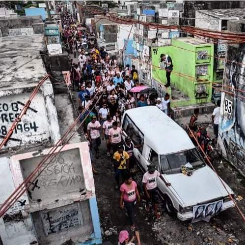 Funeral procession of suspected drug dealer in a poor Filipino neighborhood