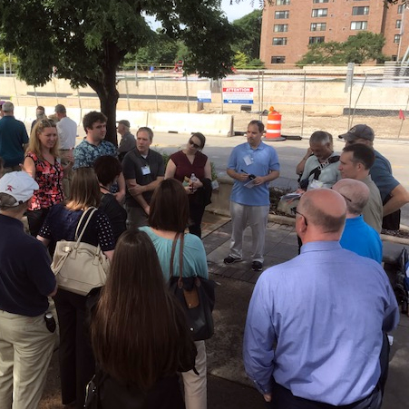 Tour attendees discussing TOD project with Stan Popovich