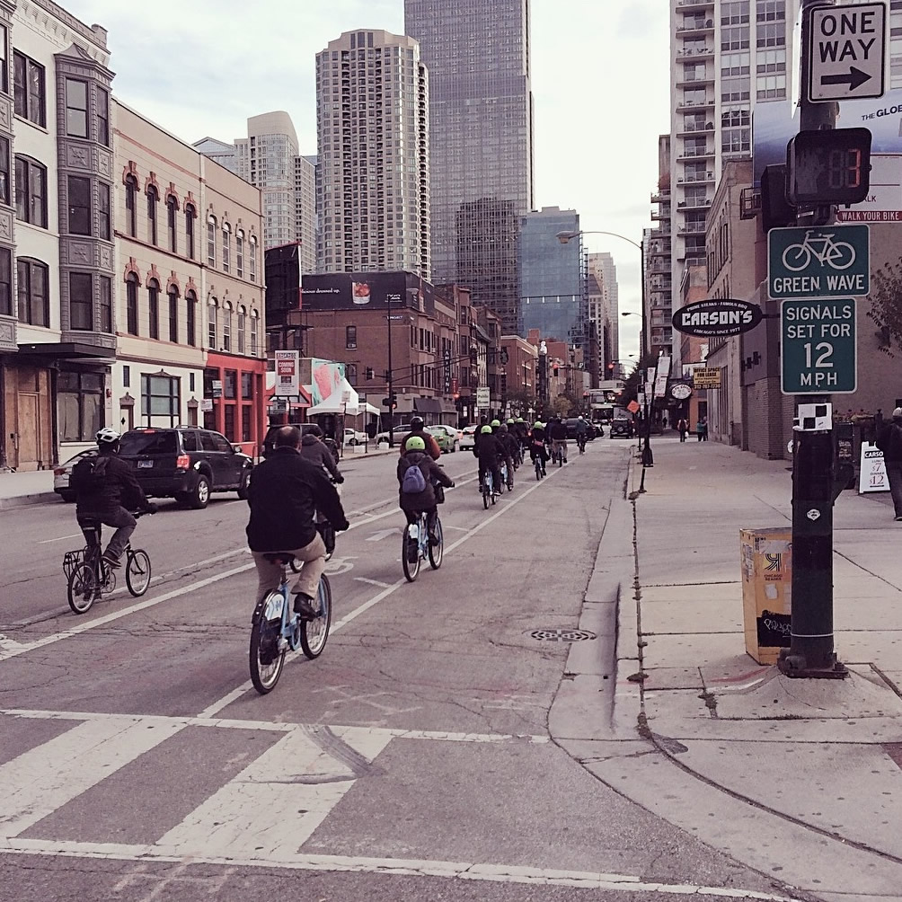 Riley O'Neil leads NACTO's bicycle tour group through Chicago's loop