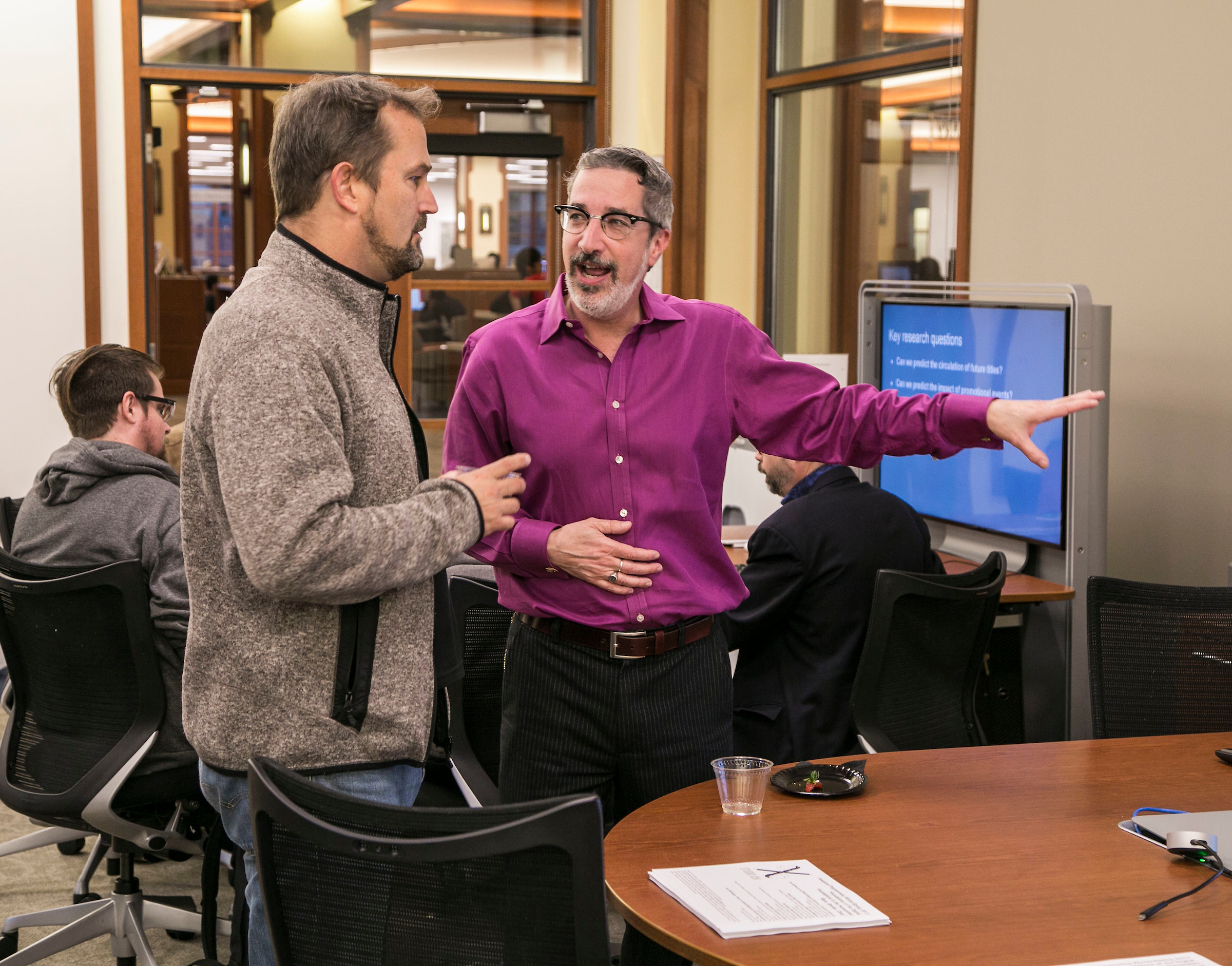 Alec Brownlow, associate professor of geography, and Paul Jaskot, director of Studio χ (CHI: Computing/Humanities Interface) look over a project during an open house (credit: DePaul University/Jamie Moncrief)