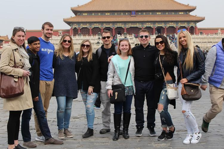 Phillip Stalley, DePaul scholarship adviser, with students in the Forbidden City